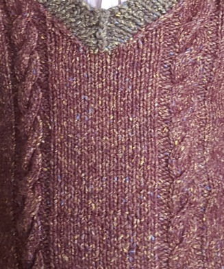 If you look closely, you'll see rows with wonky stitches, and knits through the back loop